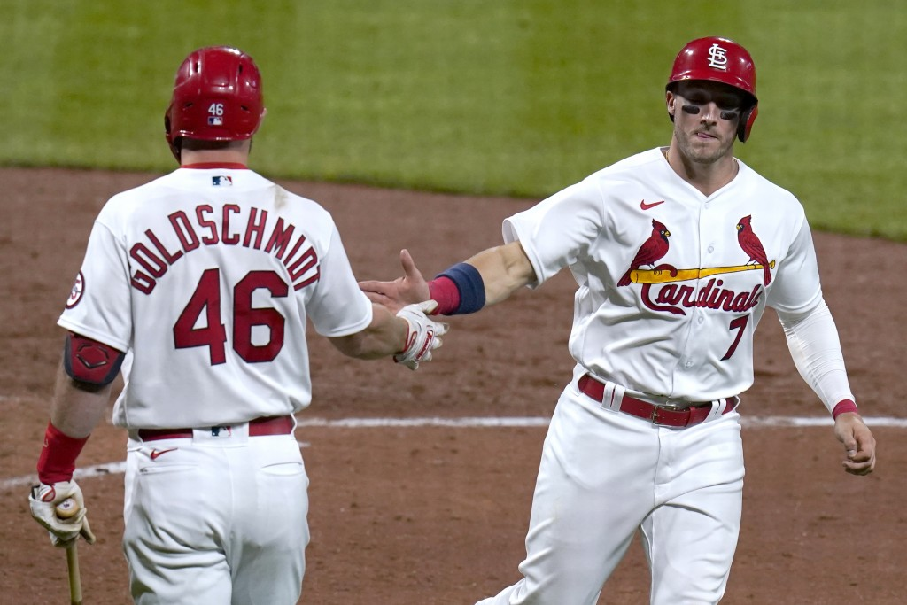 St. Louis Cardinals' Andrew Knizner is congratulated by teammate Paul Goldschmidt (46) after scoring during the fifth inning of a baseball game agains...