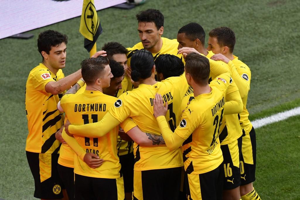 Dortmund players celebrate after Dortmund's Jadon Sancho scored his side's second goal during the German Bundesliga soccer match between Borussia Dort...
