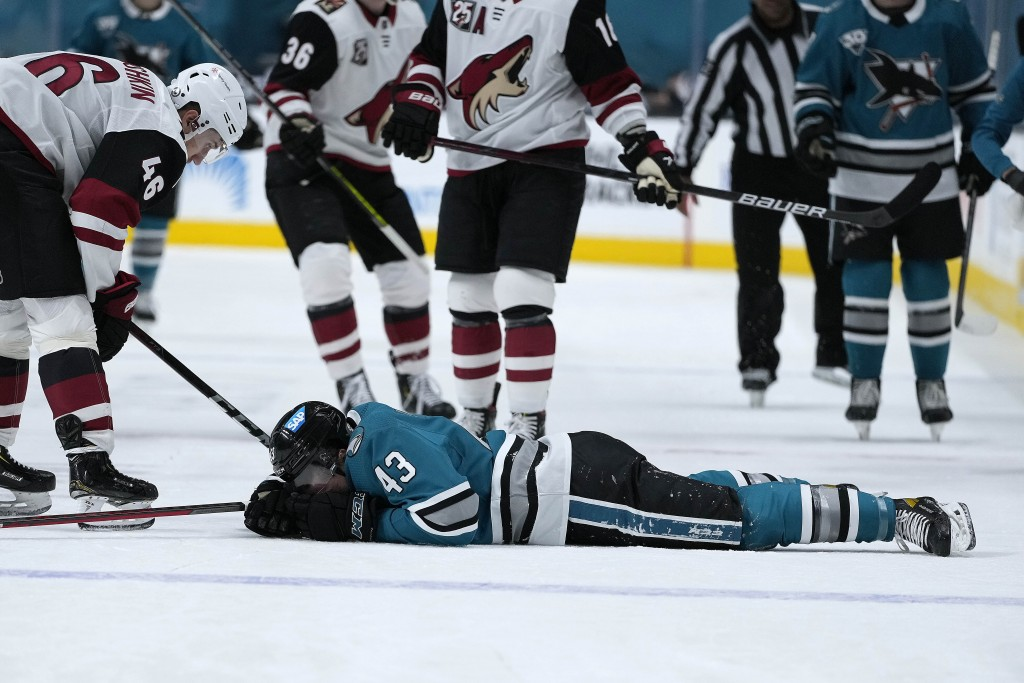 San Jose Sharks left wing John Leonard (43) lies on the ice after colliding with the boards during the first period against the Arizona Coyotes in an ...