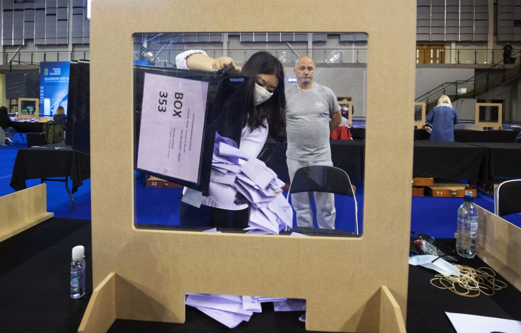 Votes are sorted to be counted for the Scottish Parliamentary Elections at the Emirates Arena,in Glasgow, Scotland, Saturday May 8, 2021. (Jane Barlow...