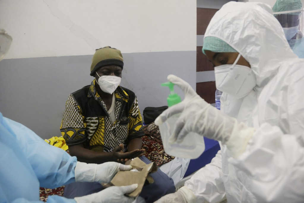 A COVID-19 patient is treated, at the Farcha provincial hospital in N'Djamena, Chad, Friday April 30, 2021. While the world's wealthier nations have s...