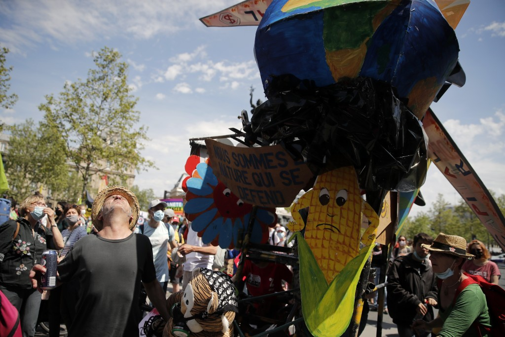 Demonstrators attend a rally against the climate change in Paris, Sunday, May 9, 2021. Thousands of French demonstrators took to the streets of Paris ...