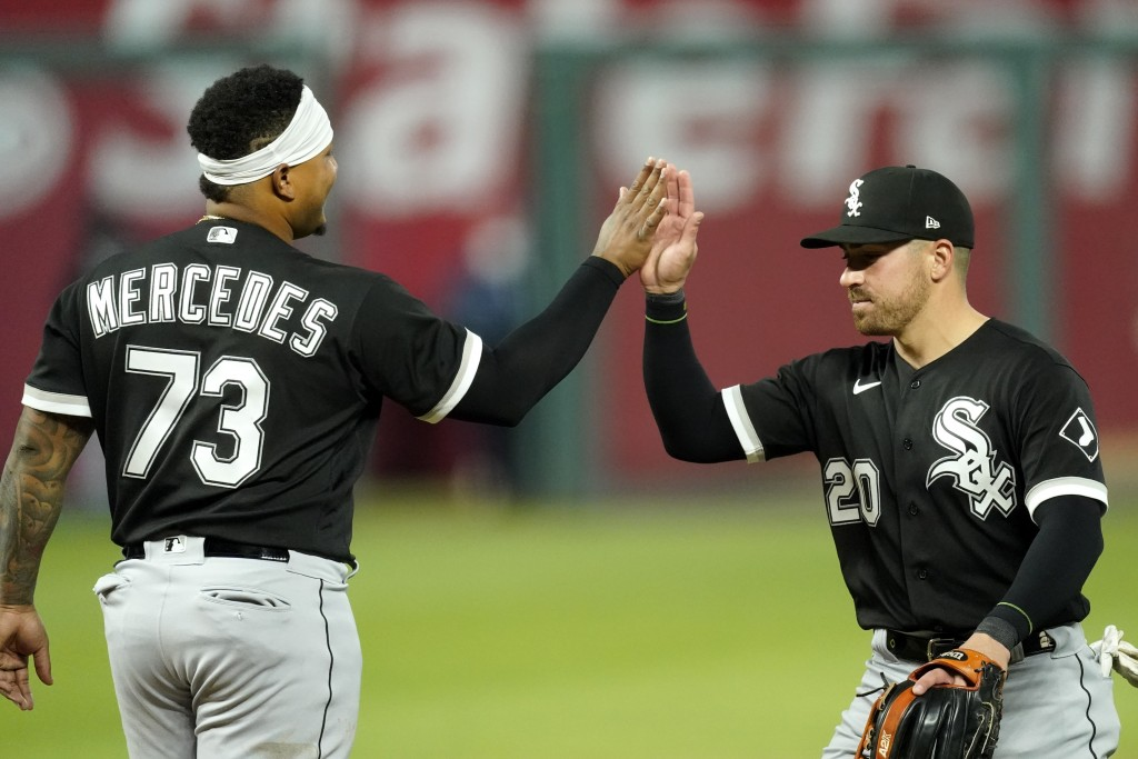 Chicago White Sox catcher Yermin Mercedes and second baseman Danny Mendick (20) celebrate after their baseball game against the Kansas City Royals Sat...