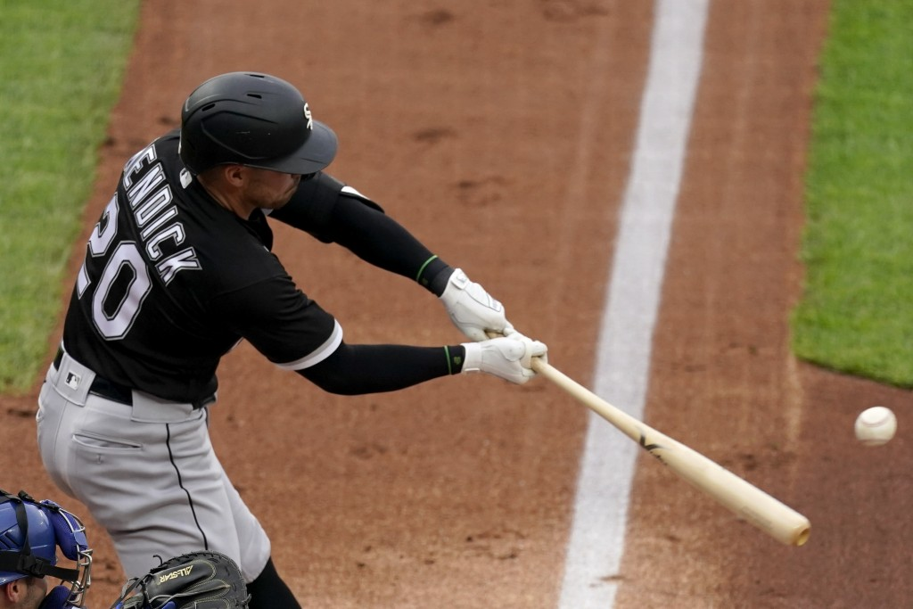 Chicago White Sox's Danny Mendick hits a two-run home run during the first inning of a baseball game against the Kansas City Royals Saturday, May 8, 2...