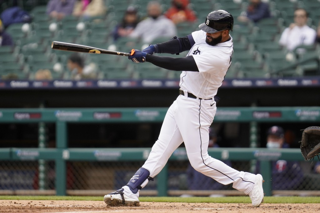 Detroit Tigers' Nomar Mazara hits a triple against the Minnesota Twins in the fourth inning of a baseball game in Detroit, Saturday, May 8, 2021. (AP ...