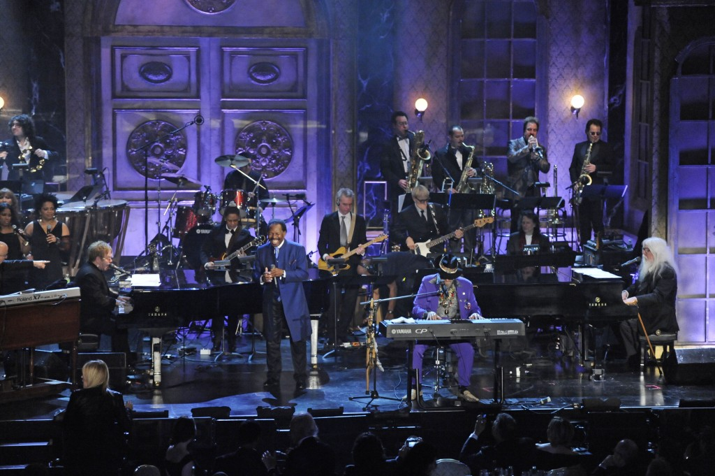 FILE - In this March 15, 2011 file photo, from left, Elton John, Lloyd Price, Dr. John, and Leon Russell perform at the Rock and Roll Hall of Fame ind...
