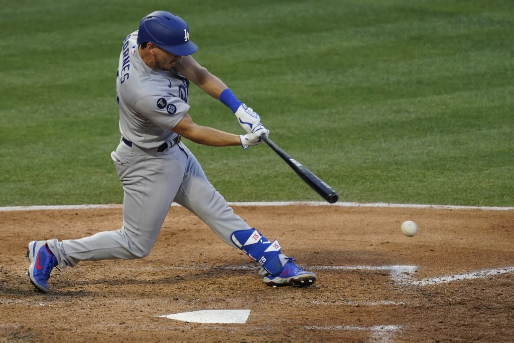 Los Angeles Dodgers' Austin Barnes (15) singles on a ground ball to Los Angeles Angels second baseman David Fletcher during the fourth inning of a bas...