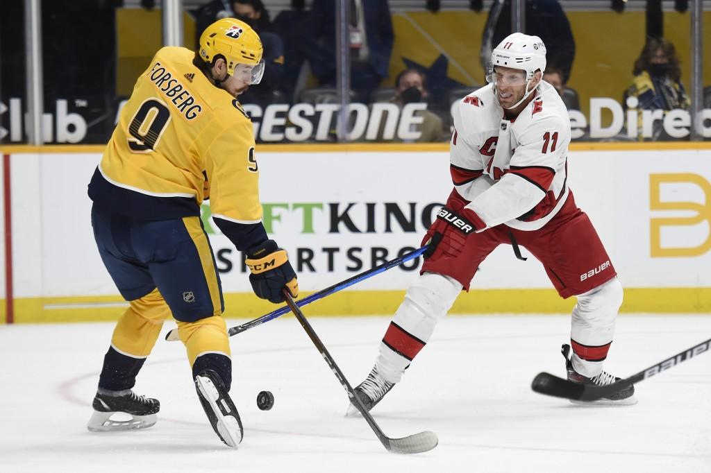 Nashville Predators left wing Filip Forsberg (9) blocks a shot by Carolina Hurricanes center Jordan Staal (11) during the first period of an NHL hocke...