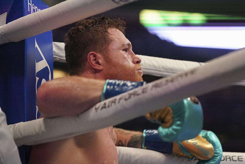 Canelo Alvarez rests in his corner during a unified super middleweight world championship boxing match against Billy Joe Saunders, Saturday, May 8, 20...