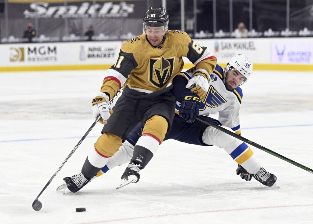 Vegas Golden Knights center Jonathan Marchessault (81) fends off St. Louis Blues defenseman Jake Walman (46) during the second period of an NHL hockey...