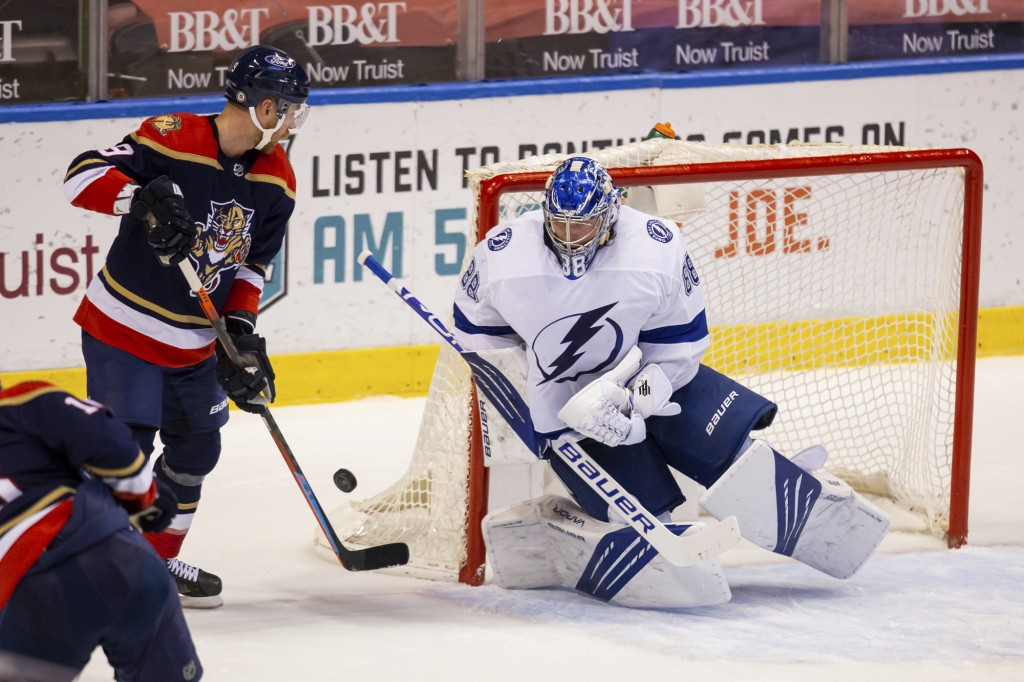 Tampa Bay Lightning goaltender Andrei Vasilevskiy (88) saves a shot on goal during the first period of an NHL hockey game against the Florida Panthers...