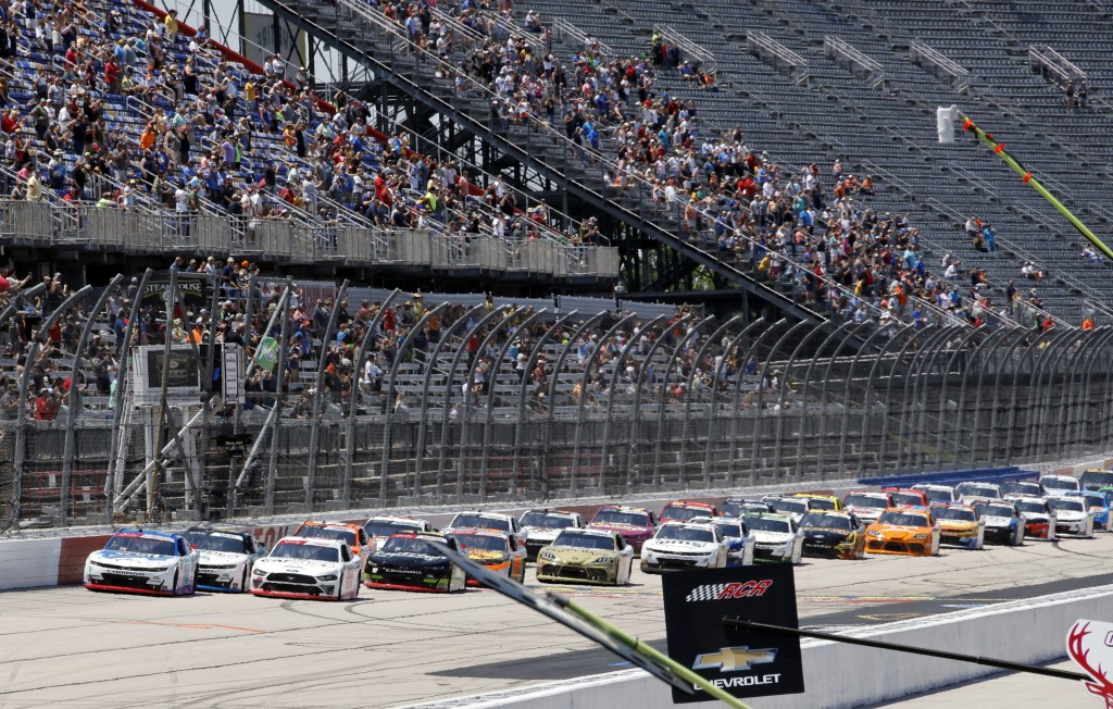 A J Allmendinger, left, leads the field at the start of the NASCAR Xfinity Series auto race at Darlington Raceway, Saturday, May 8, 2021, in Darlingto...