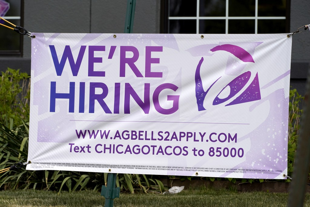 A hiring sign is displayed outside of a restaurant during the COVID-19 pandemic in Glenview, Ill., Saturday, May 8, 2021. US job growth slows sharply ...