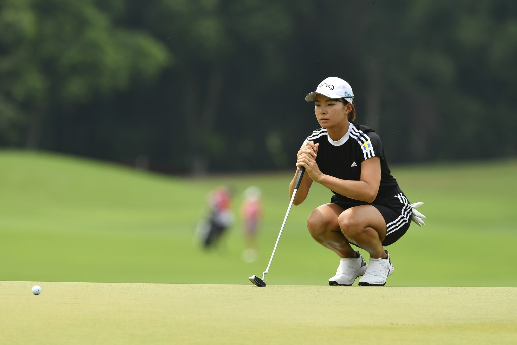 Hinako Shibuno of Japan lines up for a putt on the 18th green during the final round of the LPGA Honda Thailand golf tournament in Pattaya, southern T...