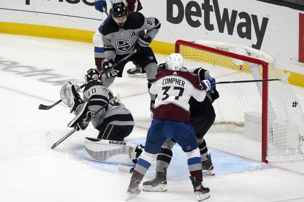 Los Angeles Kings goaltender Calvin Petersen (40) gives up a goal on a shot from Colorado Avalanche defenseman Devon Toews, not seen, during the first...