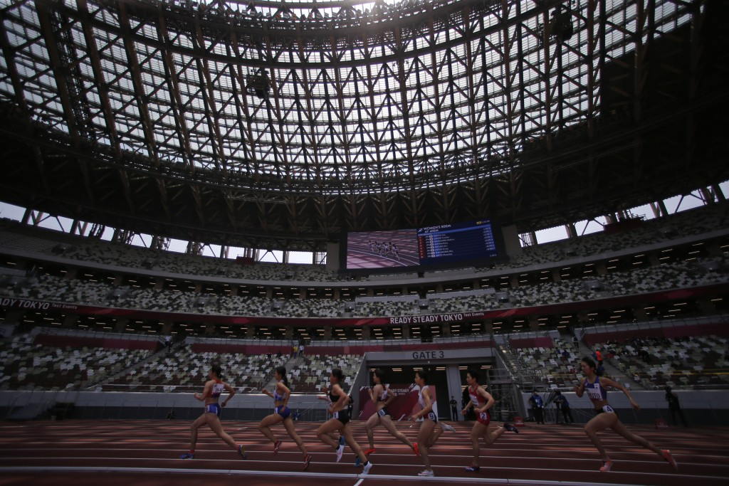 Japanese athletes compete during the women's 800 meter race at an athletics test event for the Tokyo 2020 Olympics Games at National Stadium in Tokyo,...