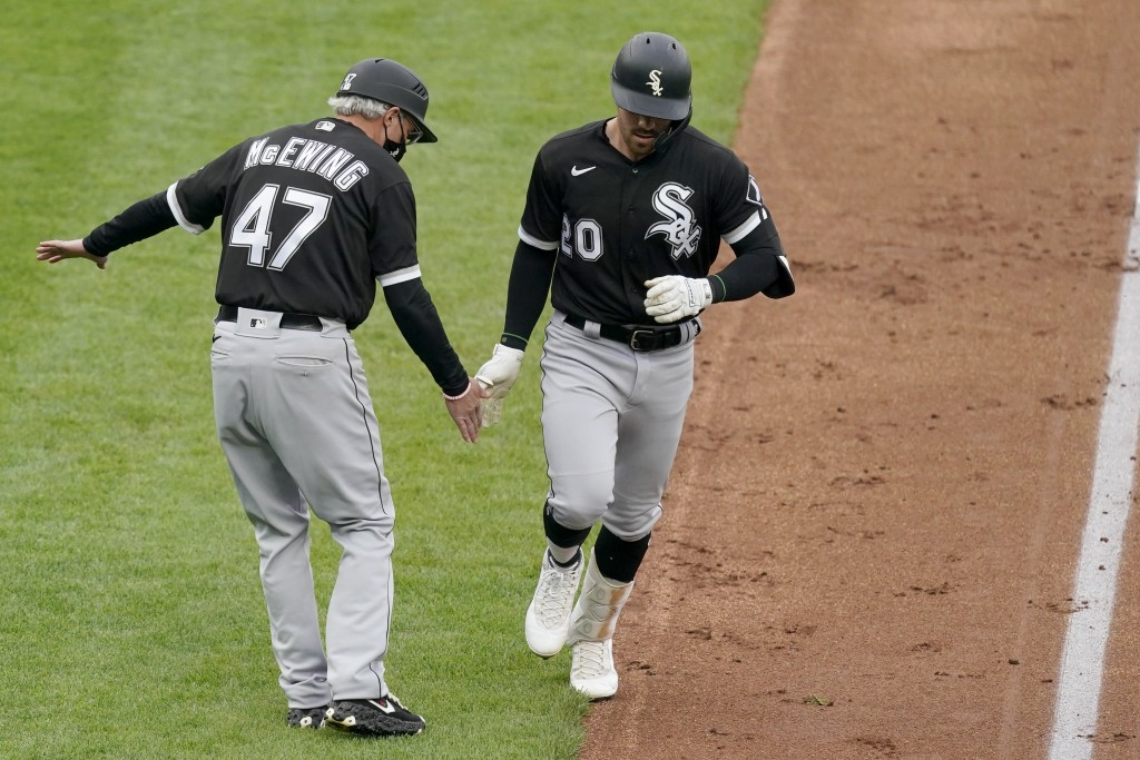 Chicago White Sox's Danny Mendick (20) celebrates with third base coach Joe McEwing (47) after hitting a two-run home run during the first inning of a...