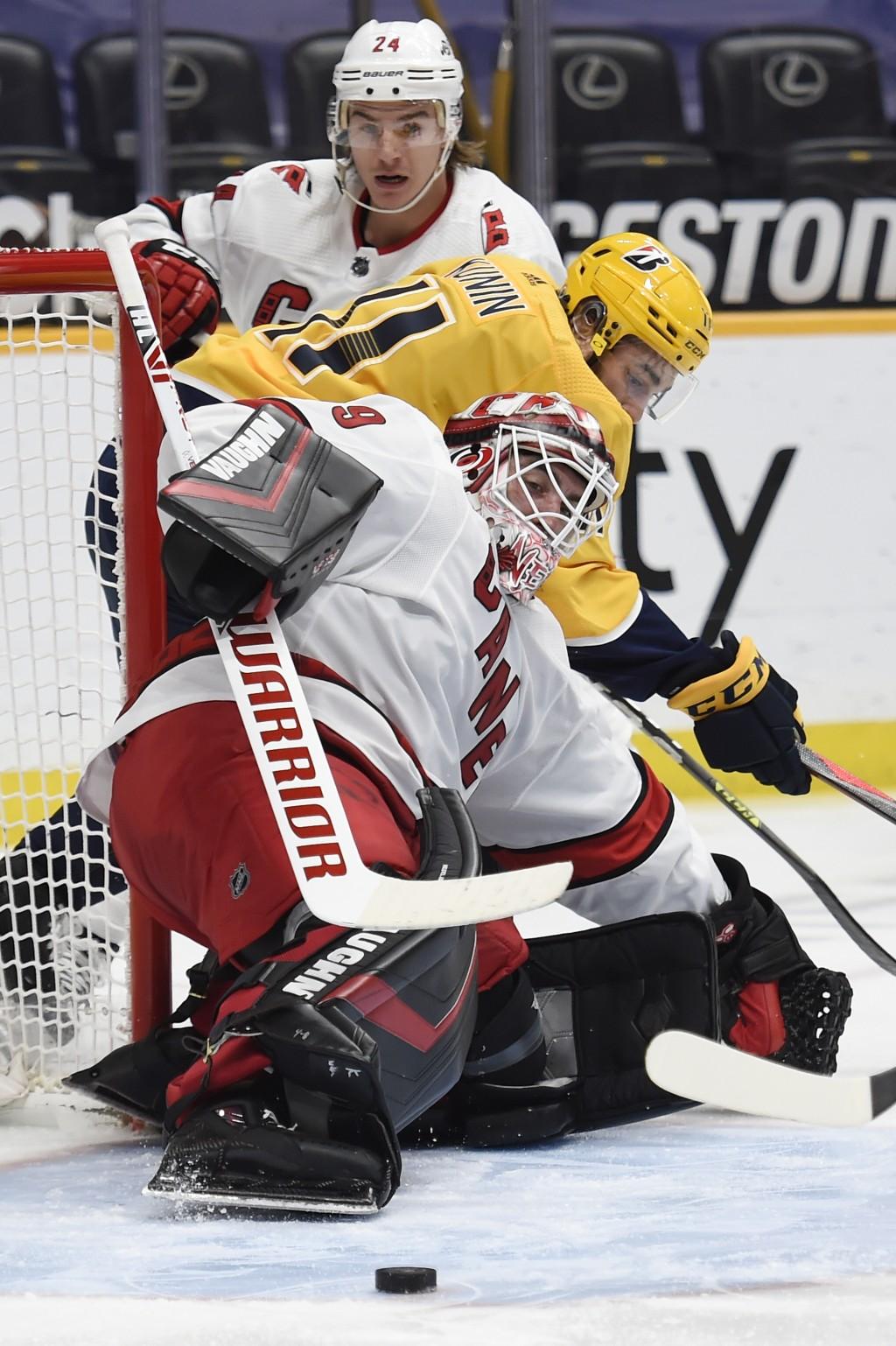 Carolina Hurricanes goaltender Alex Nedeljkovic (39) blocks a shot by the Nashville Predators during the second period of an NHL hockey game Saturday,...