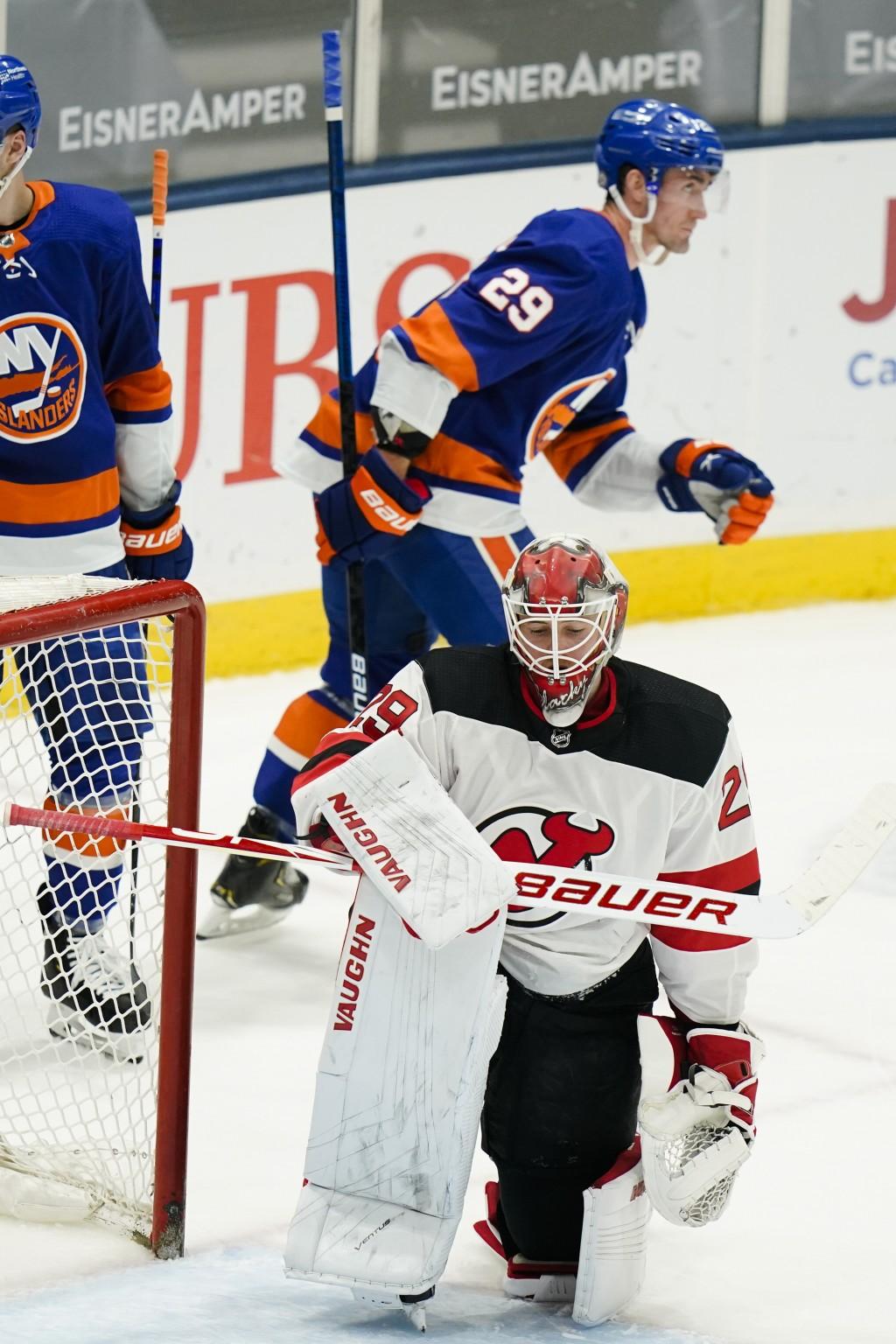 New Jersey Devils goaltender Mackenzie Blackwood (29) reacts as New York Islanders' Brock Nelson (29) skates toward his bench after scoring a goal dur...