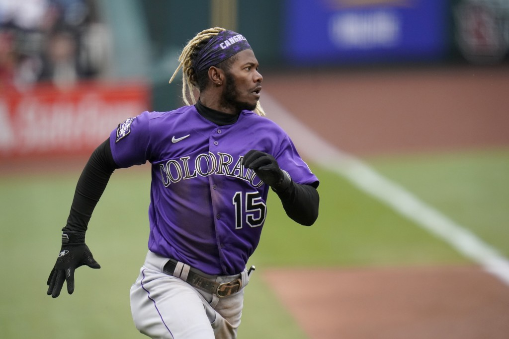 Colorado Rockies' Raimel Tapia runs in to score during the first inning of a baseball game against the St. Louis Cardinals Saturday, May 8, 2021, in S...