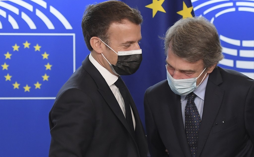 French President Emmanuel Macron, left, talks to European Parliament President David Sassoli during the Europe Day event and the Conference on the Fut...