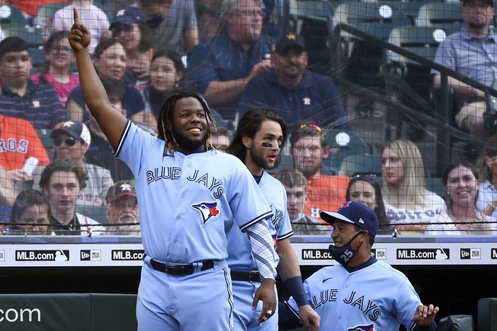 Toronto Blue Jays' Vladimir Guerrero Jr., left, celebrates Cavan Biggio's two-run home run during the second inning of the team's baseball game agains...