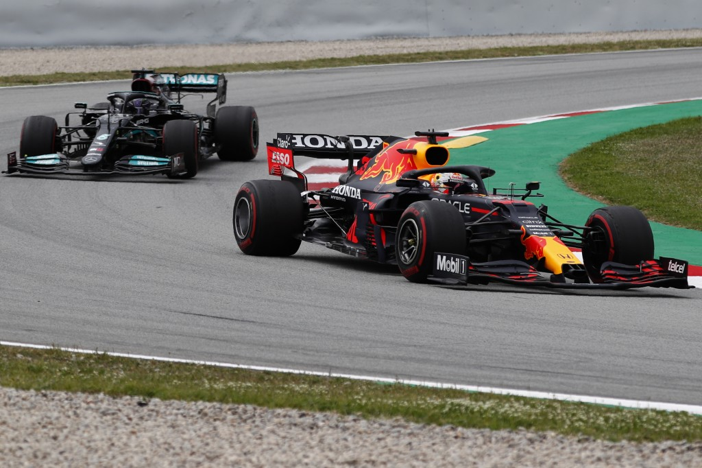 Red Bull driver Max Verstappen of the Netherlands takes a curve followed by Mercedes driver Lewis Hamilton of Britain during the Spanish Formula One G...