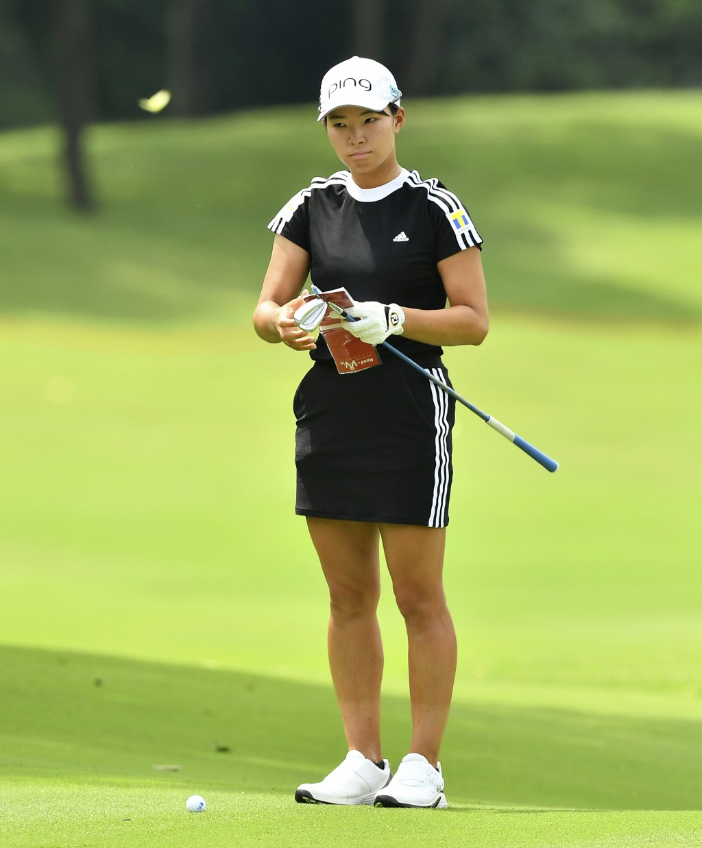 Hinako Shibuno of Japan prepares for a putt on the 18th green during the final round of the LPGA Honda Thailand golf tournament in Pattaya, southern T...