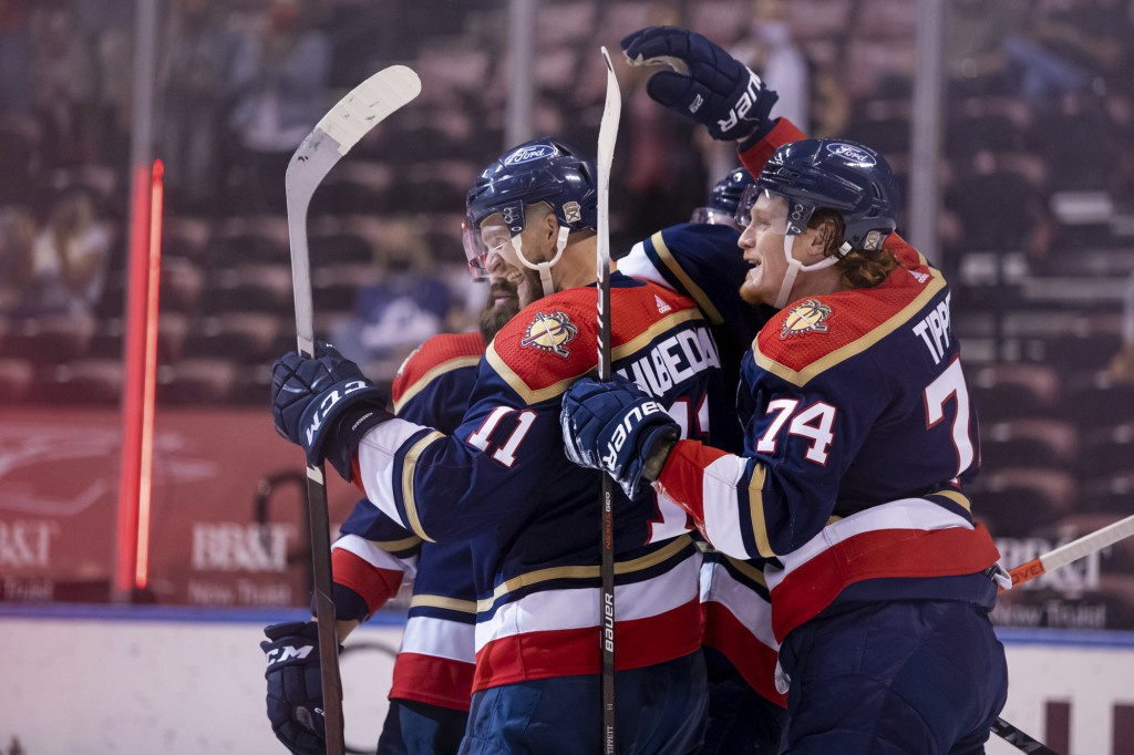 Florida Panthers left wing Jonathan Huberdeau (11) celebrates with right wing Owen Tippett (74) after scoring a goal during the second period of an NH...