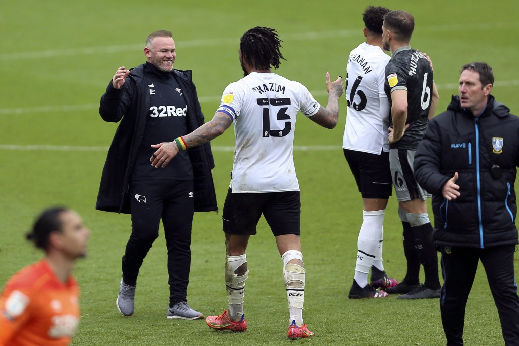 Derby County manager Wayne Rooney, left, celebrates with Colin Kazim-Richards (13) after a Sky Bet Championship soccer match at Pride Park, Saturday, ...