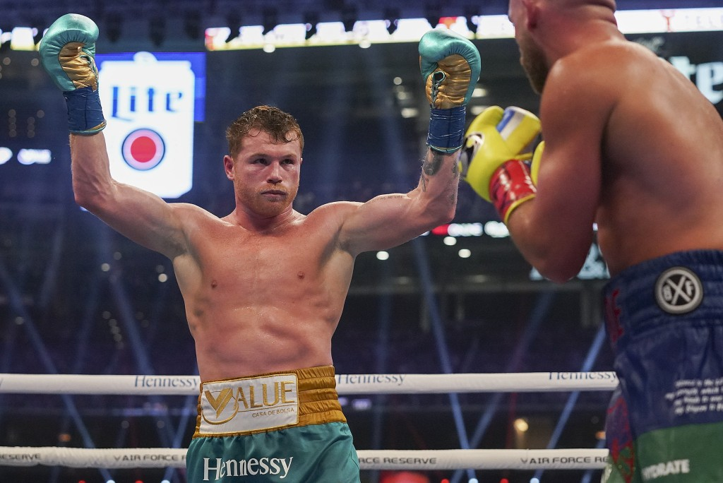Canelo Alvarez reacts during a unified super middleweight world championship boxing match against Billy Joe Saunders, Saturday, May 8, 2021, in Arling...