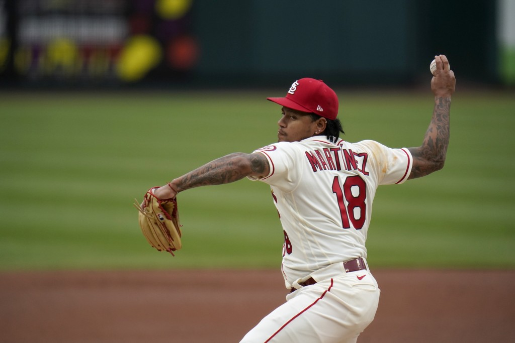 St. Louis Cardinals starting pitcher Carlos Martinez throws during the first inning of a baseball game against the Colorado Rockies Saturday, May 8, 2...