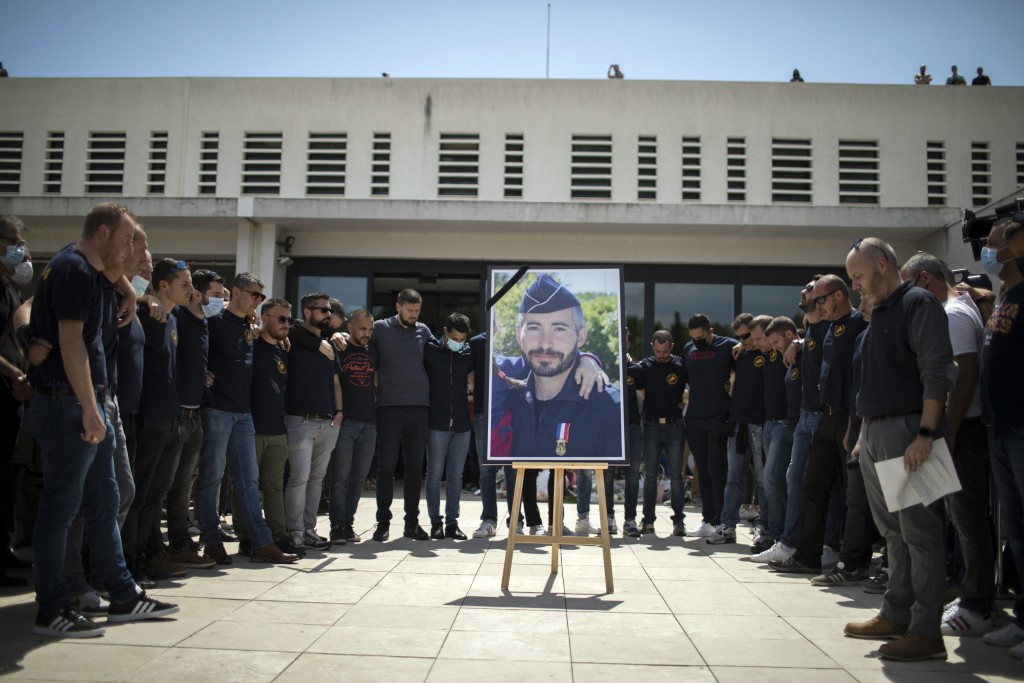 Police officers pay homage to a slain colleague at a police station in Avignon, southern France, Sunday, May 9, 2021. Police officers and civilians ga...