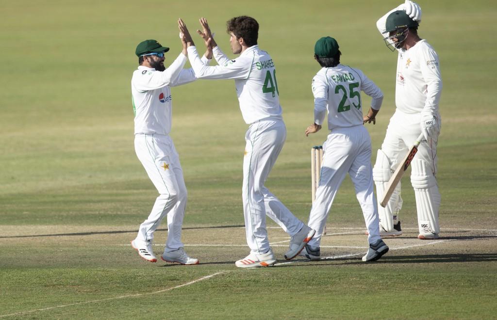 Pakistan players celebrate the wicket of Zimbabwean batsman Brendan Taylor, right, during the second test cricket match between Zimbabwe and Pakistan ...