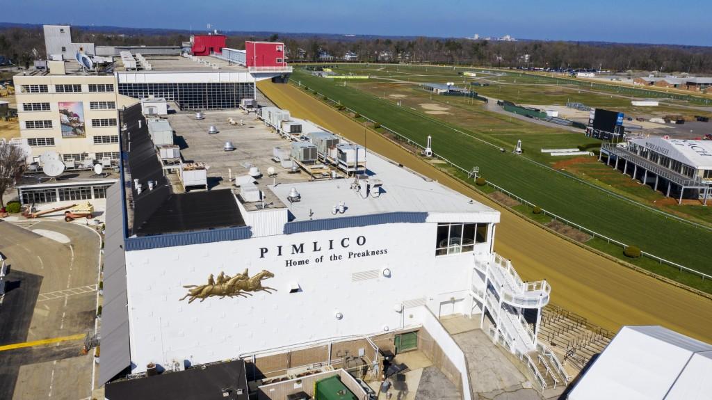 FILE - In this March 26, 2020, file photo, tractors groom the racing surface at the Pimlico Race Course in Baltimore. Pimlico, which opened in 1870, i...