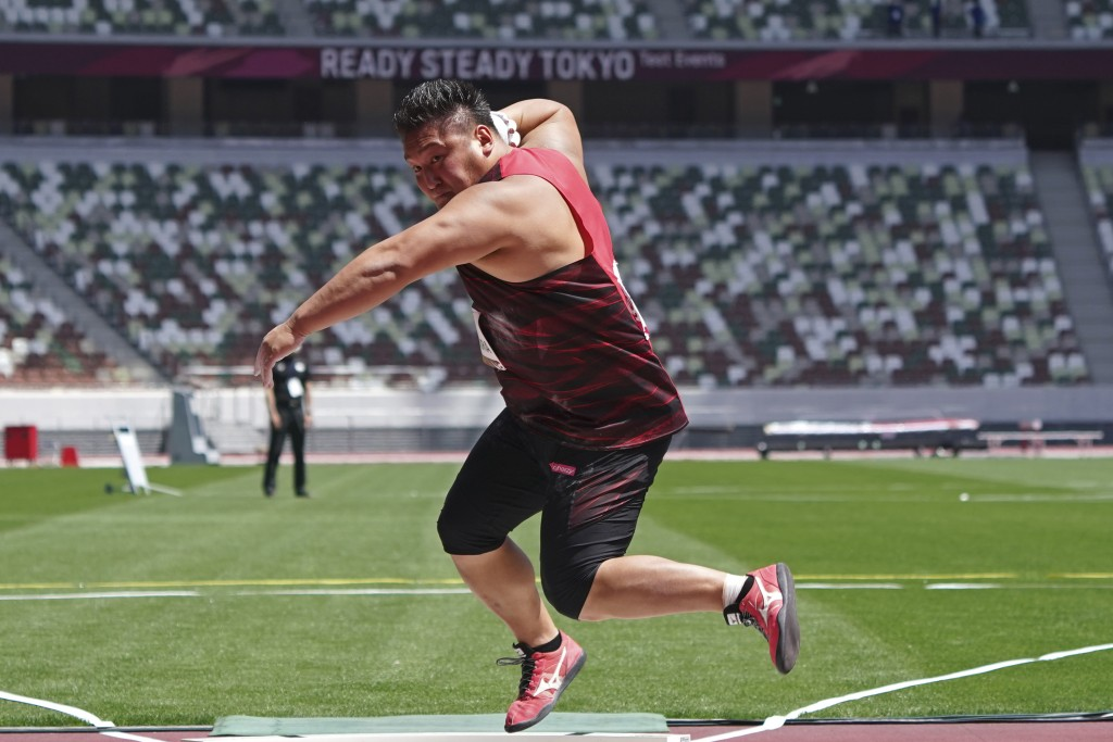 Japanese Daichi Nakamura performs a shot put at an athletics test event for the Tokyo 2020 Olympics Games at National Stadium in Tokyo, Sunday, May 9,...