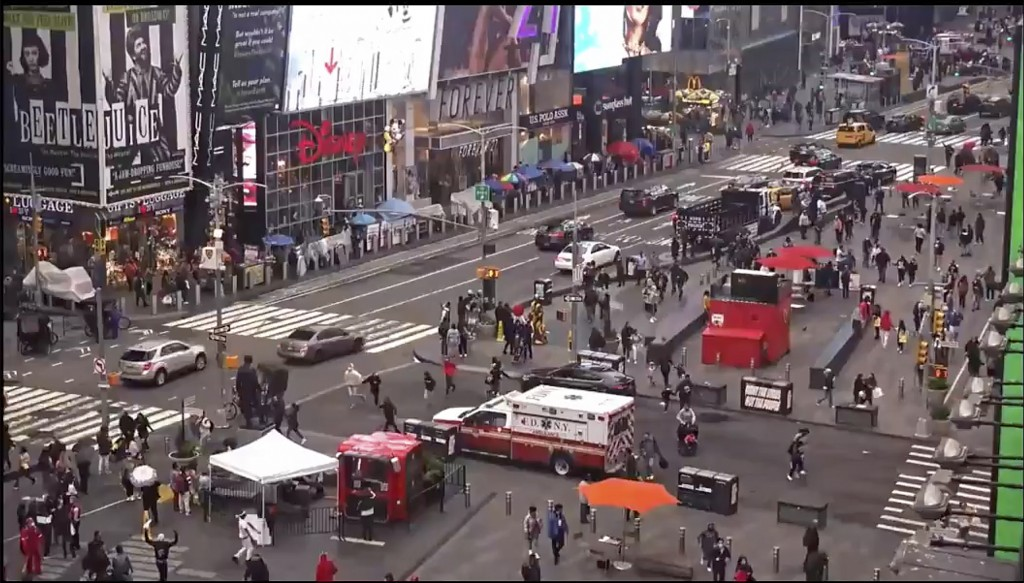 In this image taken from video by the FDNY, pedestrians hurry away from the scene of a shooting in Times Square, Saturday, May 8, 2021, in New York. N...