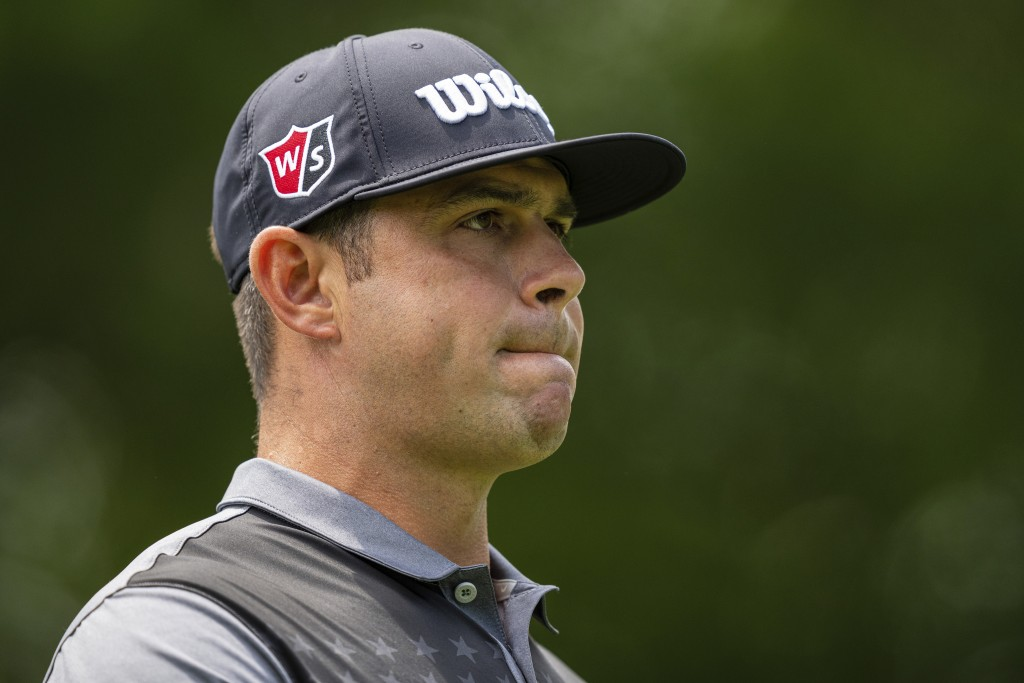 Gary Woodland looks down the fairway on the second hole during the third round of the Wells Fargo Championship golf tournament at Quail Hollow on Satu...