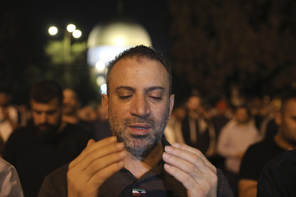 A worshipper prays during the Laylat al-Qadr, or the night of destiny, in the holy fasting month of Ramadan, in the Al Aqsa Mosque compound in Jerusal...