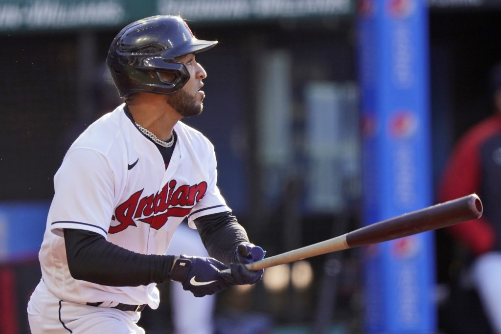 Cleveland Indians' Eddie Rosario watches his RBI double during the first inning of the team's baseball game against the Cincinnati Reds, Saturday, May...