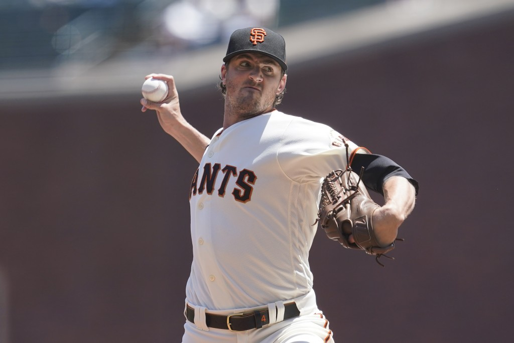 San Francisco Giants' Kevin Gausman pitches against the San Diego Padres during the first inning of a baseball game in San Francisco, Saturday, May 8,...