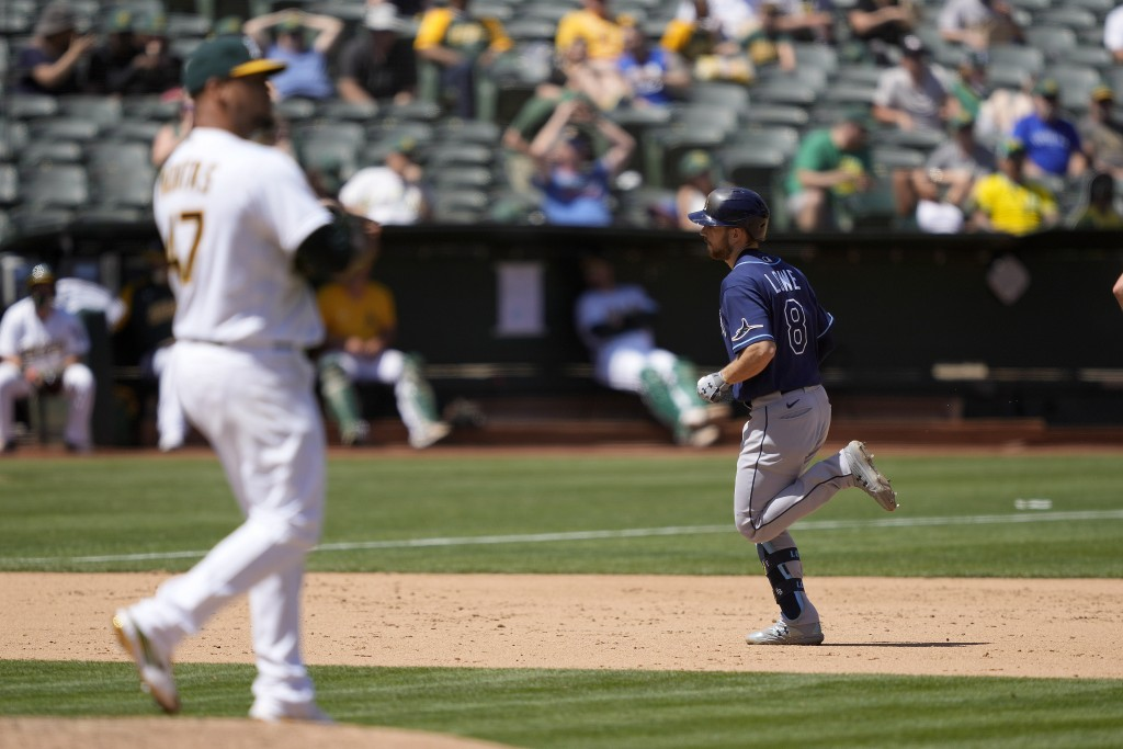 Tampa Bay Rays' Brandon Lowe (8) rounds the bases after hitting a two-run home run off Oakland Athletics starting pitcher Frankie Montas (47) during t...