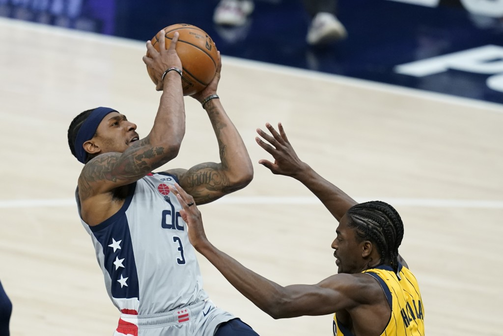 Washington Wizards' Bradley Beal (3) puts up a shot against Indiana Pacers' Justin Holiday (8) during the first half of an NBA basketball game, Saturd...