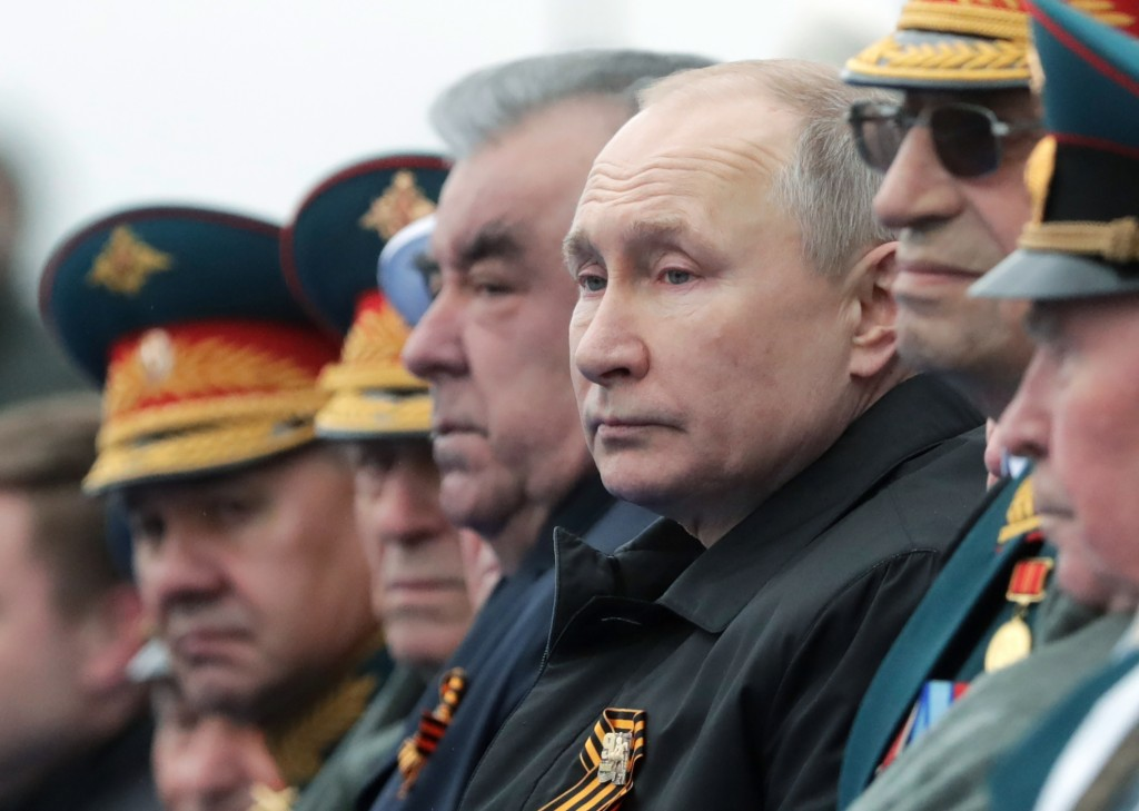 Russian President Vladimir Putin, center right, and Tajikistan's President Emomali Rakhmon, center left, watch the Victory Day military parade in Mosc...