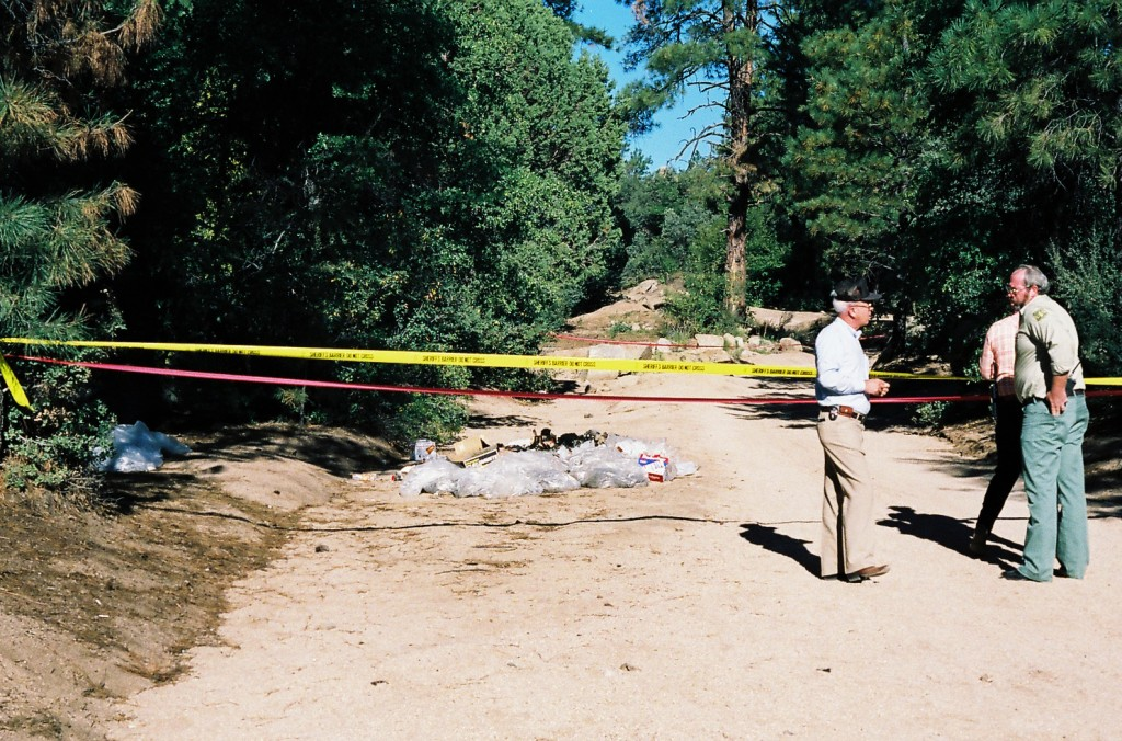 This undated photo provided by the Yavapai County Sheriff's Office shows authorities at the site outside Prescott, Ariz., where Pamela Pitts' body was...