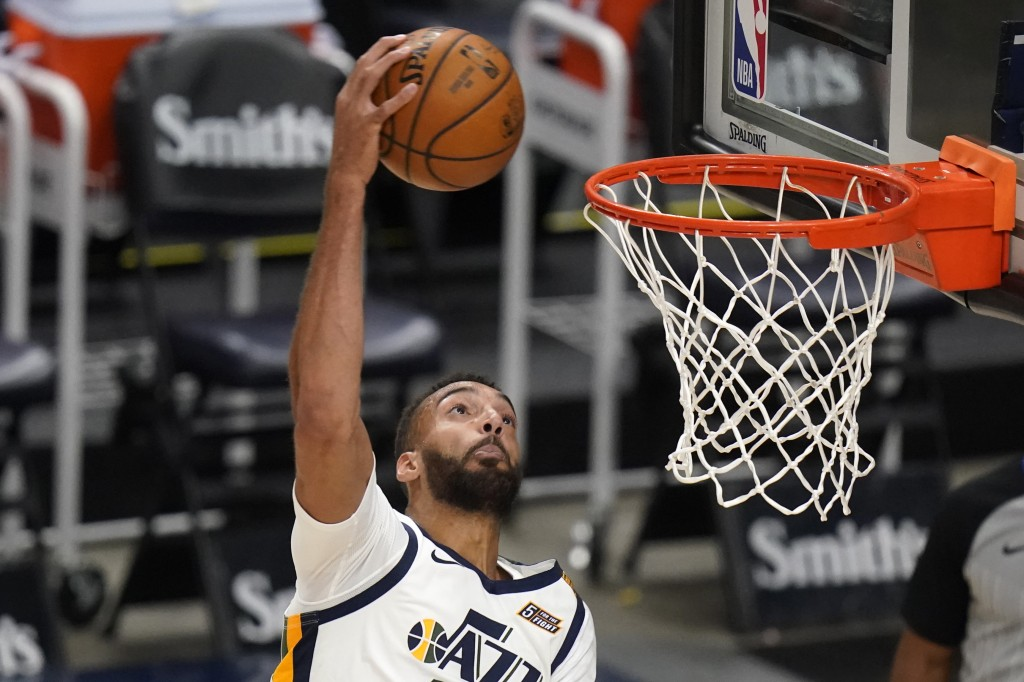 Utah Jazz center Rudy Gobert goes to the basket against the Houston Rockets during the second half of an NBA basketball game Saturday, May 8, 2021, in...
