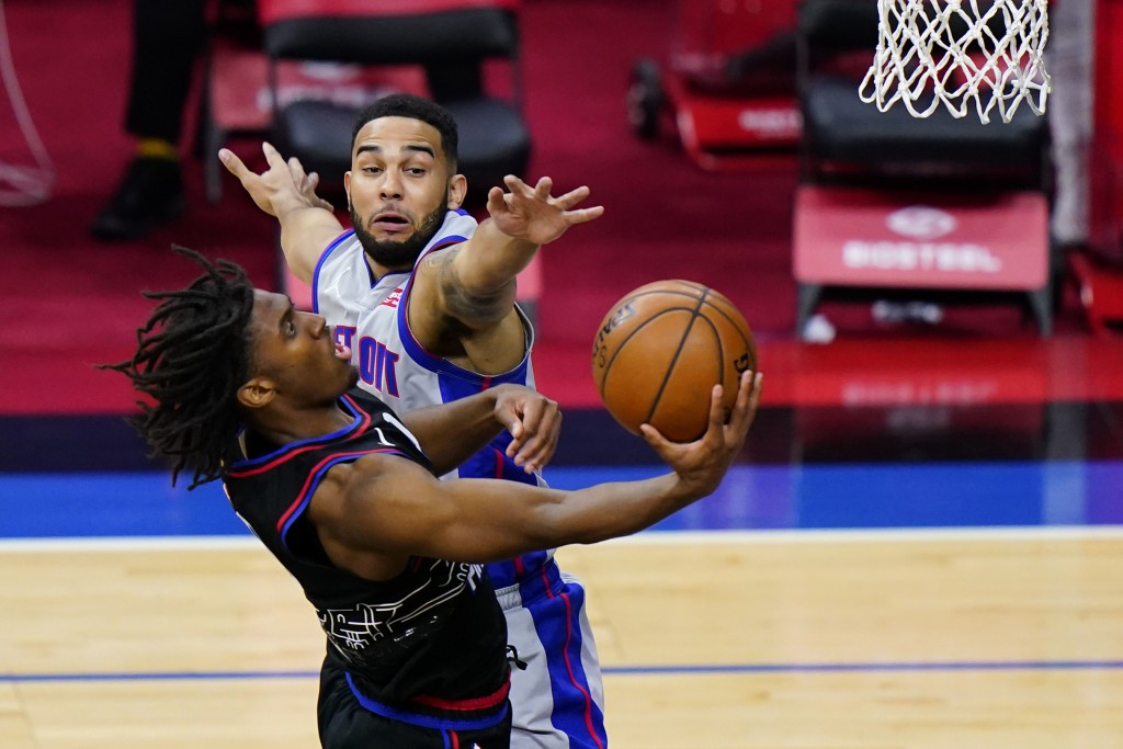 Philadelphia 76ers' Tyrese Maxey, left, goes up for a shot against Detroit Pistons' Cory Joseph during the second half of an NBA basketball game, Satu...