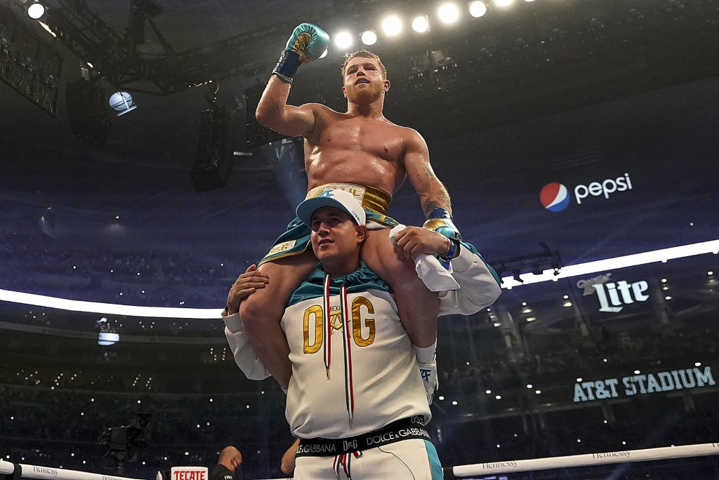 Canelo Alvarez celebrates after defeating Billy Joe Saunders in a unified super middleweight world championship boxing match, Saturday, May 8, 2021, i...