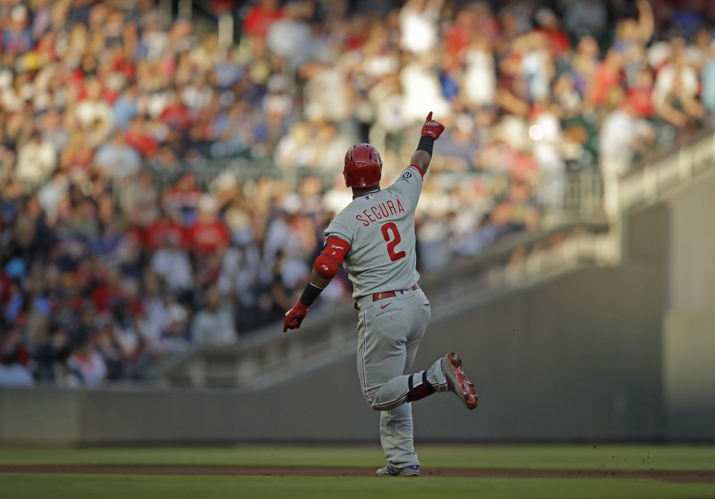 Philadelphia Phillies' Jean Segura celebrates after hitting a home run off Atlanta Braves pitcher Ian Anderson in the first inning of a baseball game ...