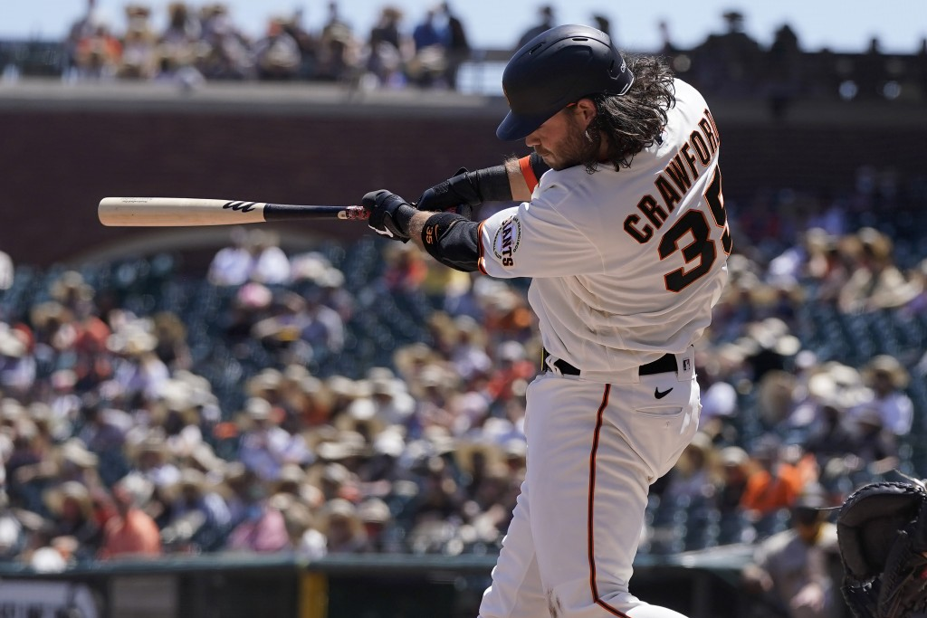 San Francisco Giants' Brandon Crawford hits a three-run home run against the San Diego Padres during the second inning of a baseball game in San Franc...